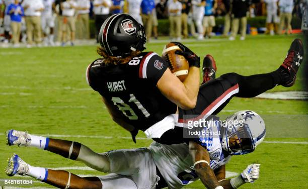 Tight end Hayden Hurst of the South Carolina Gamecocks is upended by defensive back Derrick Baity of the Kentucky Wildcats at WilliamsBrice Stadium...