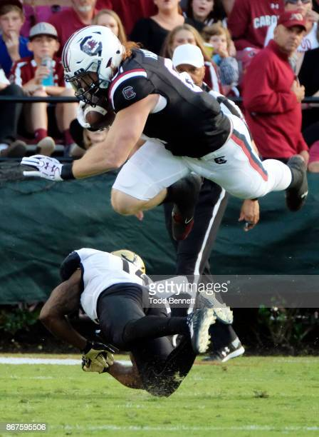 Tight end Hayden Hurst of the South Carolina Gamecocks is upended by defensive back Ryan White of the Vanderbilt Commodores at WilliamsBrice Stadium...