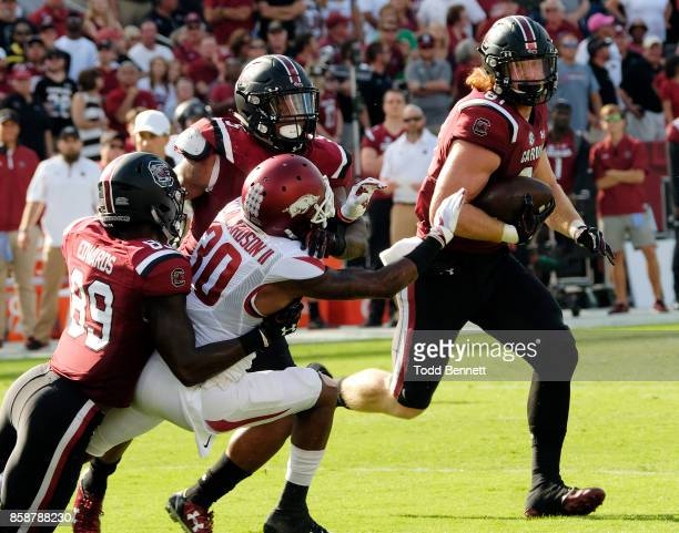 Tight end Hayden Hurst of the South Carolina Gamecocks tries to elude defensive back Kevin Richardson II of the Arkansas Razorbacks at WilliamsBrice...