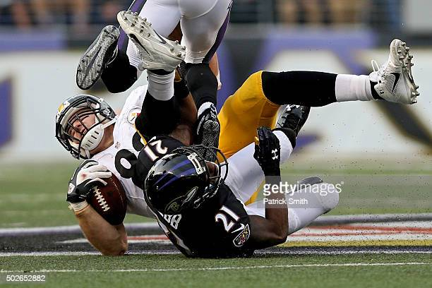 tight end Heath Miller of the Pittsburgh Steelers is tackled by cornerback Lardarius Webb of the Baltimore Ravens in the second half at MT Bank...