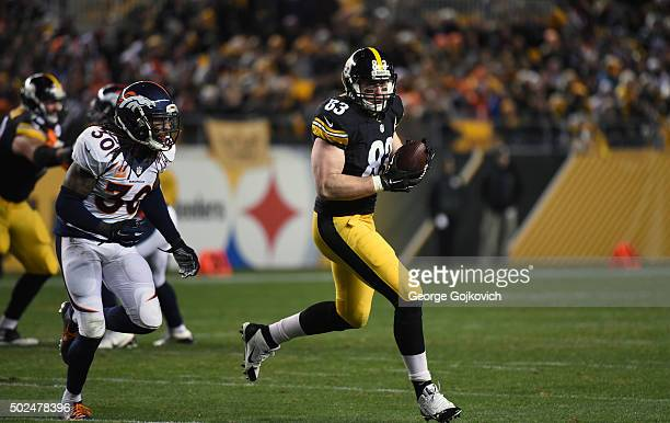 Tight end Heath Miller of the Pittsburgh Steelers runs with the football after catching a pass as he is pursued by safety David Bruton Jr of the...