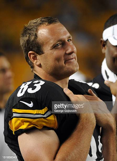 Tight end Heath Miller of the Pittsburgh Steelers smiles as he looks on from the sideline during a preseason game against the Carolina Panthers at...
