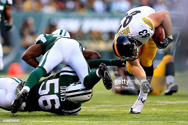 Tight end Heath Miller of the Pittsburgh Steelers tries to avoid a tackle by inside linebacker Demario Davis of the New York Jets during a game at...