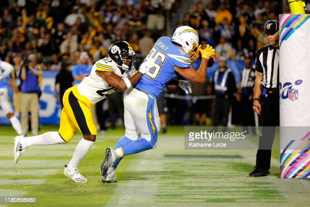 Tight end Hunter Henry of the Los Angeles Chargers makes the touchdown as cornerback Joe Haden of the Pittsburgh Steelers defends during the fourth...