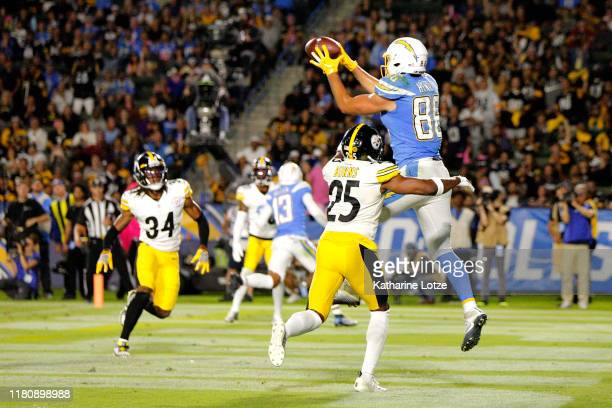 Tight end Hunter Henry of the Los Angeles Chargers makes the catch for a touchdown as cornerback Joe Haden of the Pittsburgh Steelers defends during...