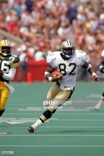 Tight end Irv Smith of the New Orleans Saints carries the ball during a pre-season game on August 14, 1993 against the Green Bay Packers. The Saints...