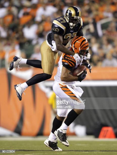 Tight end J P Foschi of the Cincinnati Bengals runs after the catch against David Roach of the St Louis Rams during the preseason game at Paul Brown...