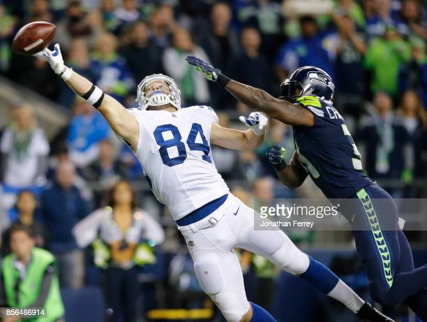 Tight end Jack Doyle of the Indianapolis Colts can't bring in a pass against strong safety Kam Chancellor of the Seattle Seahawks in the third...