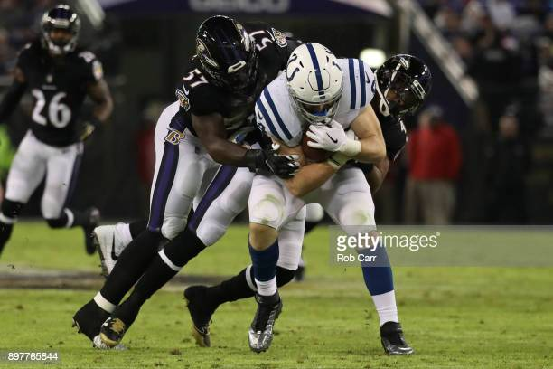 Tight End Jack Doyle of the Indianapolis Colts catches a pass as he is tackled by inside linebacker CJ Mosley of the Baltimore Ravens at MT Bank...