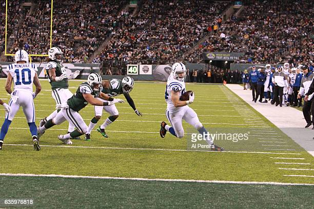 Tight End Jack Doyle of the Indianapolis Colts has a long gain against the New York Jets during their game at MetLife Stadium on December 5 2016 in...
