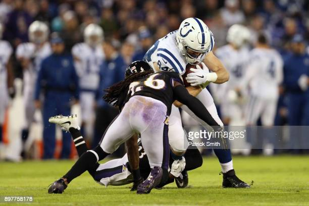 Tight End Jack Doyle of the Indianapolis Colts is tackled by cornerback Maurice Canady of the Baltimore Ravens in the first quarter at MT Bank...