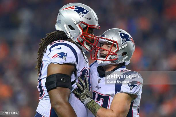 Tight end Jacob Hollister of the New England Patriots celebrates with LaAdrian Waddle after forcing a turnover on a miffed punt in the first quarter...