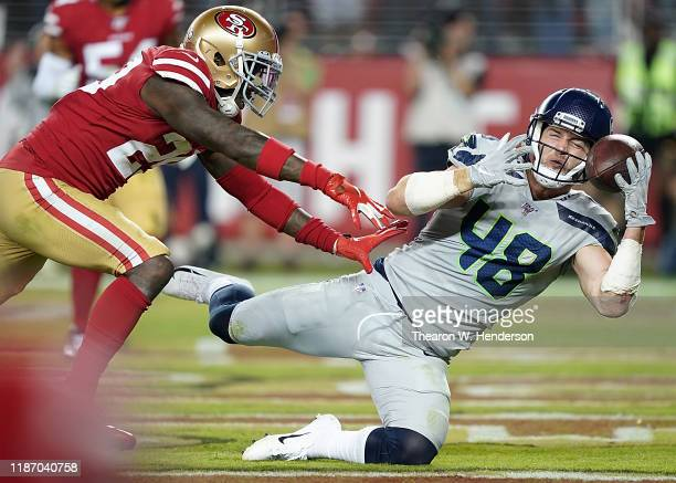 Tight end Jacob Hollister of the Seattle Seahawks catches a pass for a touchdown over strong safety Jaquiski Tartt of the San Francisco 49ers in the...