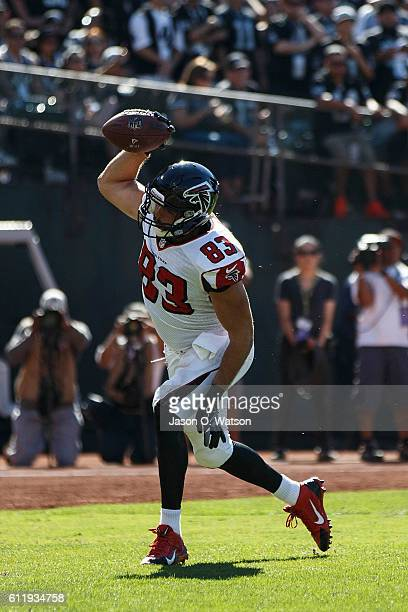Tight end Jacob Tamme of the Atlanta Falcons celebrates after scoring a touchdown against the Oakland Raiders during the third quarter at...