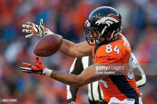 Tight end Jacob Tamme of the Denver Broncos bobbles a catch that he would then fumble and lose at the end of the first half of a game against the...