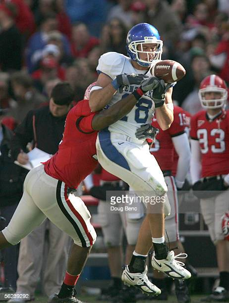 Tight end Jacob Tamme of the Kentucky Wildcats can't make the catch under the pressure from safety Greg Blue of the Georgia Bulldogs on November 19...