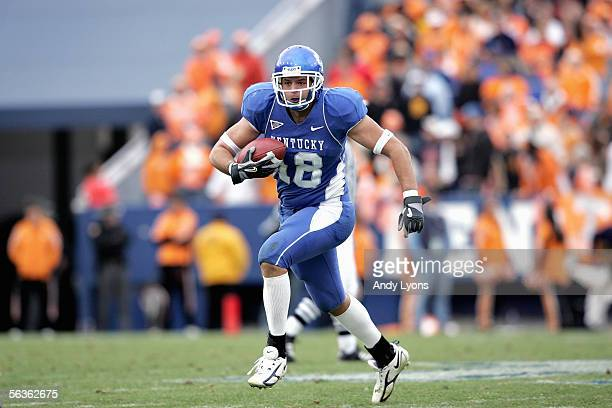 Tight end Jacob Tamme of the Kentucky Wildcats carries the ball against the Tennessee Volunteers at Commonwealth Stadium on November 26 2005 in...