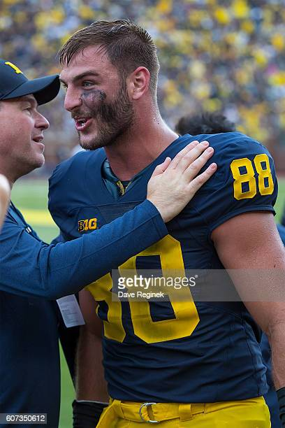 Tight end Jake Butt of the Michigan Wolverines talks on the sidelines after scoring a touchdown during a college football game against the UCF...