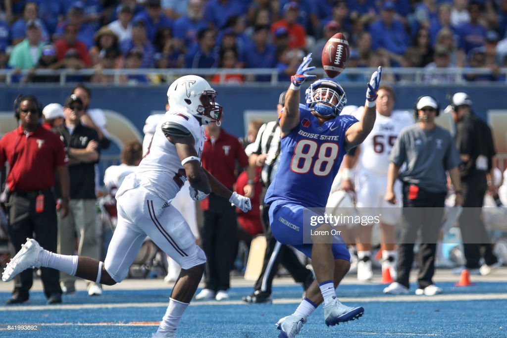 Tight end Jake Roh #88 of the Boise State Broncos tries to grab a tip ball during second half action against the Troy Trojans on September 2, 2017 at Albertsons Stadium in Boise, Idaho. Boise State won the game 24-13.