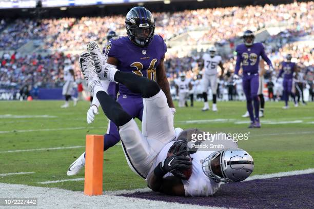 Tight End Jared Cook of the Oakland Raiders catches a touchdown in the third quarter against the Baltimore Ravens at MT Bank Stadium on November 25...