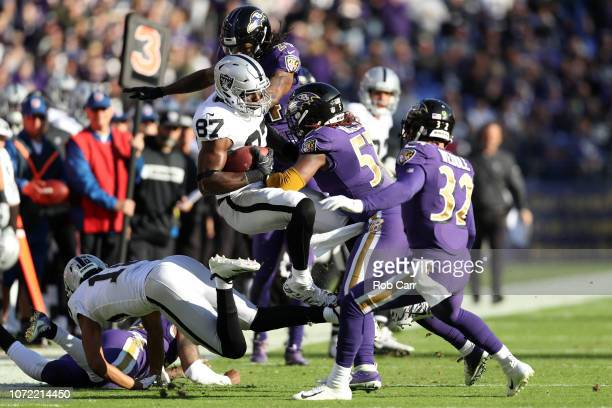 Tight End Jared Cook of the Oakland Raiders is tackled after a catch by inside linebacker CJ Mosley of the Baltimore Ravens in the second quarter at...
