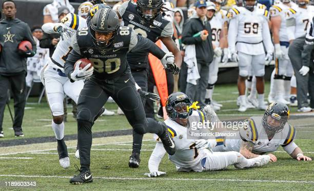 Tight end Jared Pinkney of the Vanderbilt Commodores breaks out of a tackle to score a touchdown against the East Tennessee State Buccaneers during...