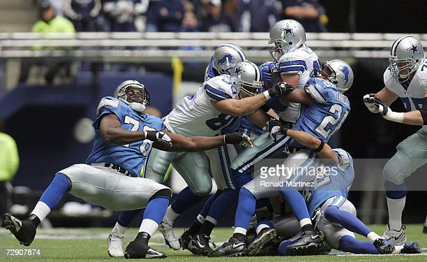 Tight end Jason Witten of the Dallas Cowboys is tackled by Kenoy Kennedy of the Detroit Lions at Texas Stadium on December 31 2006 in Irving Texas
