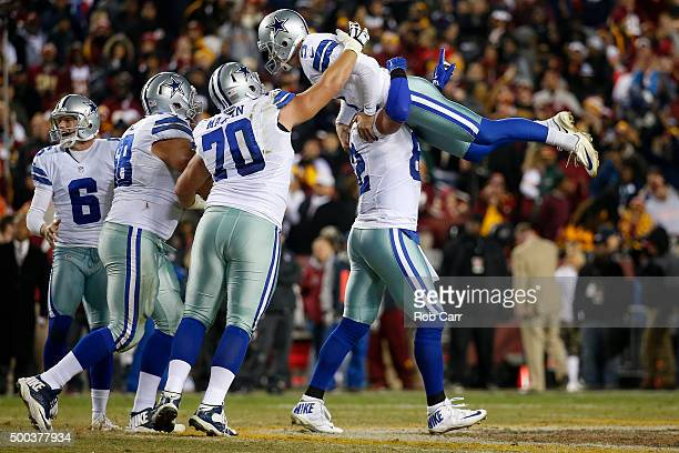Tight end Jason Witten of the Dallas Cowboys lifts up Dan Bailey after Bailey kicked the gamewinning field goal with seconds remaining to defeat the...