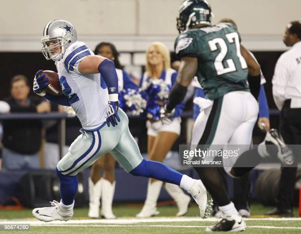 Tight end Jason Witten of the Dallas Cowboys runs after a catch making it to the oneyard line during the 2010 NFC wildcard playoff game against the...