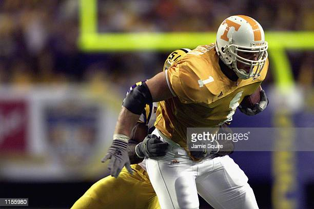 Tight end Jason Witten of the Tennessee Volunteers runs with the ball during the Southeastern Conference Championship Game against the LSU Tigers on...