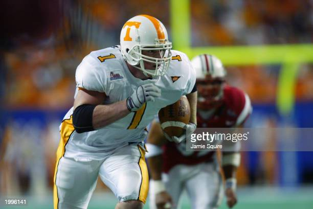 Tight end Jason Witten of the University of Tennessee Volunteers carries the ball against the University of Maryland Terrapins during the Chick-Fil-A...