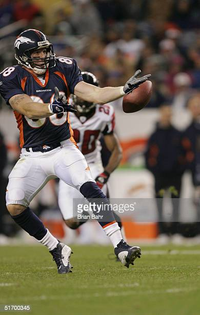 Tight end Jeb Putzier of the Denver Broncos tries to catch a ball thrown behind him against the Atlanta Falcons in the fourth quarter on October 31...