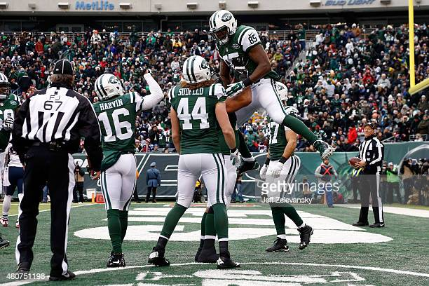 Tight end Jeff Cumberland of the New York Jets celebrates a touchdown in the second quarter against the New England Patriots during a game at MetLife...