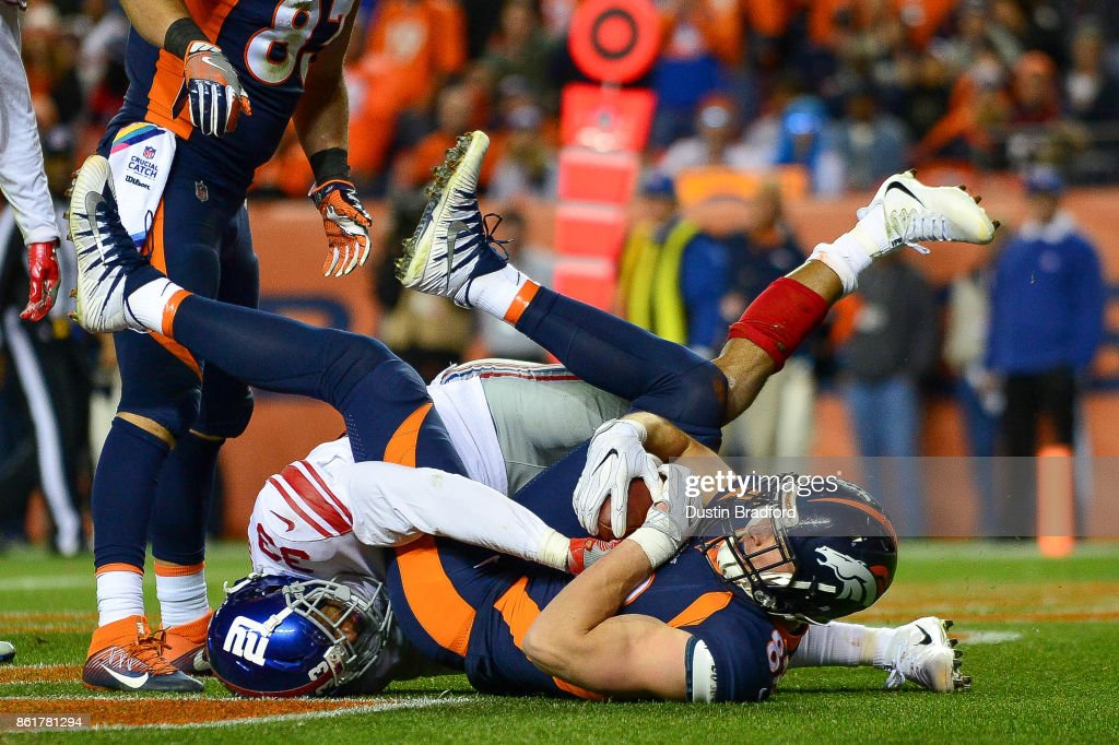 Tight end Jeff Heuerman #82 of the Denver Broncos is brought down in the end zone after a fourth quarter touchdown against the New York Giants at Sports Authority Field at Mile High on October 15, 2017 in Denver, Colorado.