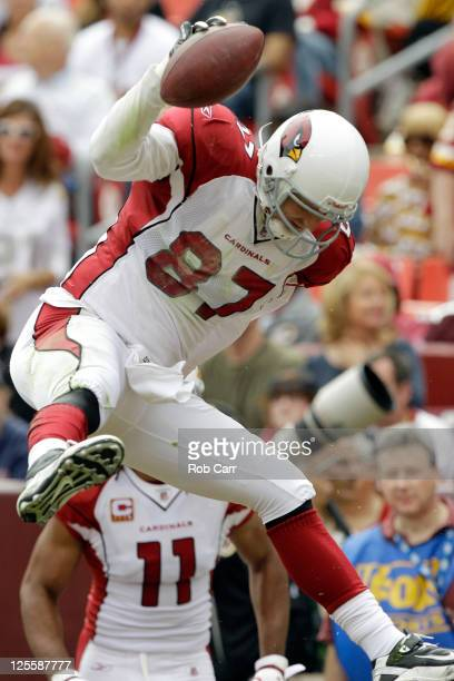 Tight end Jeff King of the Arizona Cardinals spikes the ball after scoring a touchdown against the Washington Redskins during the first half at...