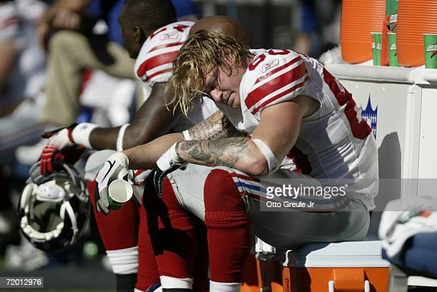 Tight end Jeremy Shockey of the New York Giants sits on the bench on the sideline in the second half of the game against the Seattle Seahawks at...