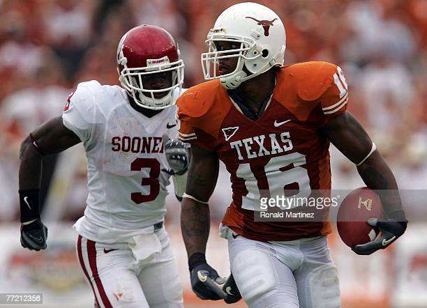 Tight end Jermichael Finley of the Texas Longhorns runs past Reggie Smith of the Oklahoma Sooners at the Cotton Bowl October 6 2007 in Dallas Texas