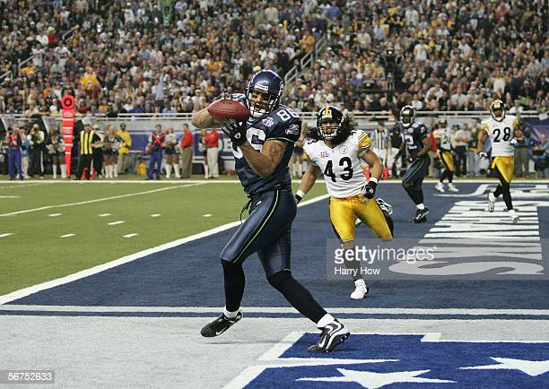 Tight end Jerramy Stevens of the Seattle Seahawks catches a 16yard touchdown pass against Troy Polamalu of the Pittsburgh Steelers during the third...