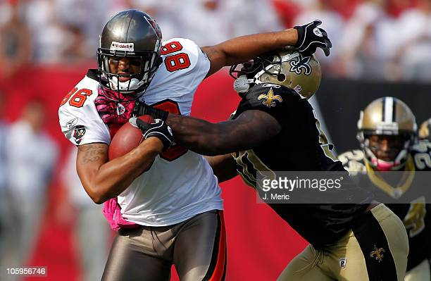 Tight end Jerramy Stevens of the Tampa Bay Buccaneers straight arms linebacker Marvin Mitchell of the New Orleans Saints during the game at Raymond...