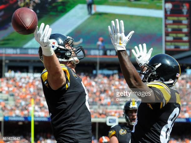 Tight end Jesse James and wide receiver Antonio Brown of the Pittsburgh Steelers celebrate a touchdown by James in the second quarter of a game on...