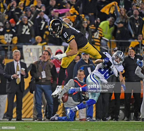 Tight end Jesse James of the Pittsburgh Steelers falls forward after leaping over safety Jeff Heath of the Dallas Cowboys during a game at Heinz...