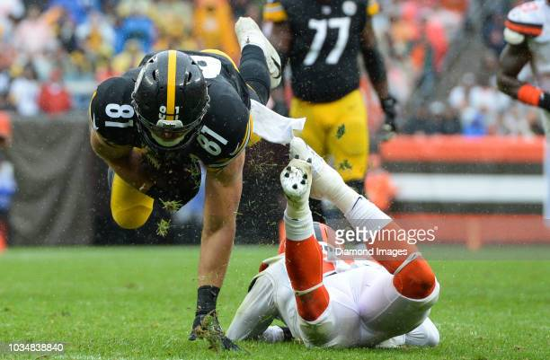 Tight end Jesse James of the Pittsburgh Steelers is tackled by defensive back Derrick Kindred of the Cleveland Browns in the second quarter of a game...