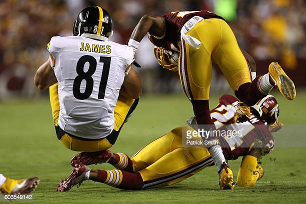 Tight end Jesse James of the Pittsburgh Steelers is tackled by defensive back Josh Norman of the Washington Redskins in the second quarter at...
