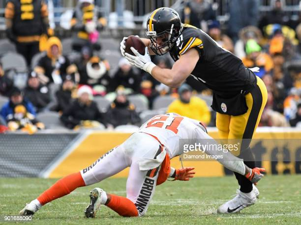 Tight end Jesse James of the Pittsburgh Steelers is tackled by cornerback Jamar Taylor of the Cleveland Browns in the fourth quarter of a game on...
