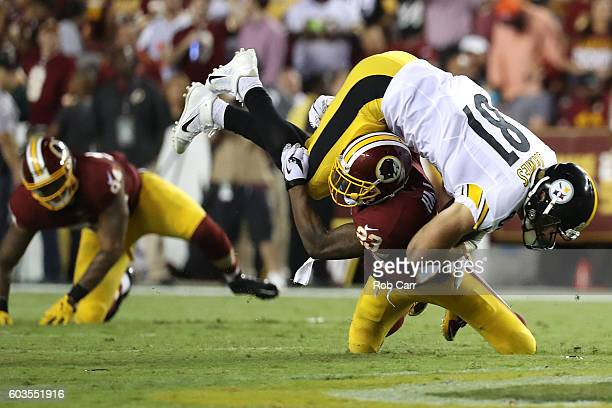 Tight end Jesse James of the Pittsburgh Steelers is tackled by strong safety DeAngelo Hall of the Washington Redskins in the second quarter at...