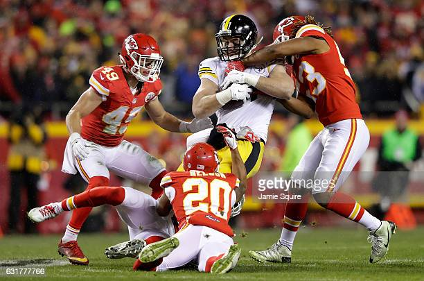Tight end Jesse James of the Pittsburgh Steelers is tackled inside linebacker Ramik Wilson of the Kansas City Chiefs and teammates Steven Nelson and...