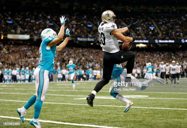 Tight end Jimmy Graham of the New Orleans Saints catches a 27yard touchdown in the second quarter against the Miami Dolphins at the MercedesBenz...