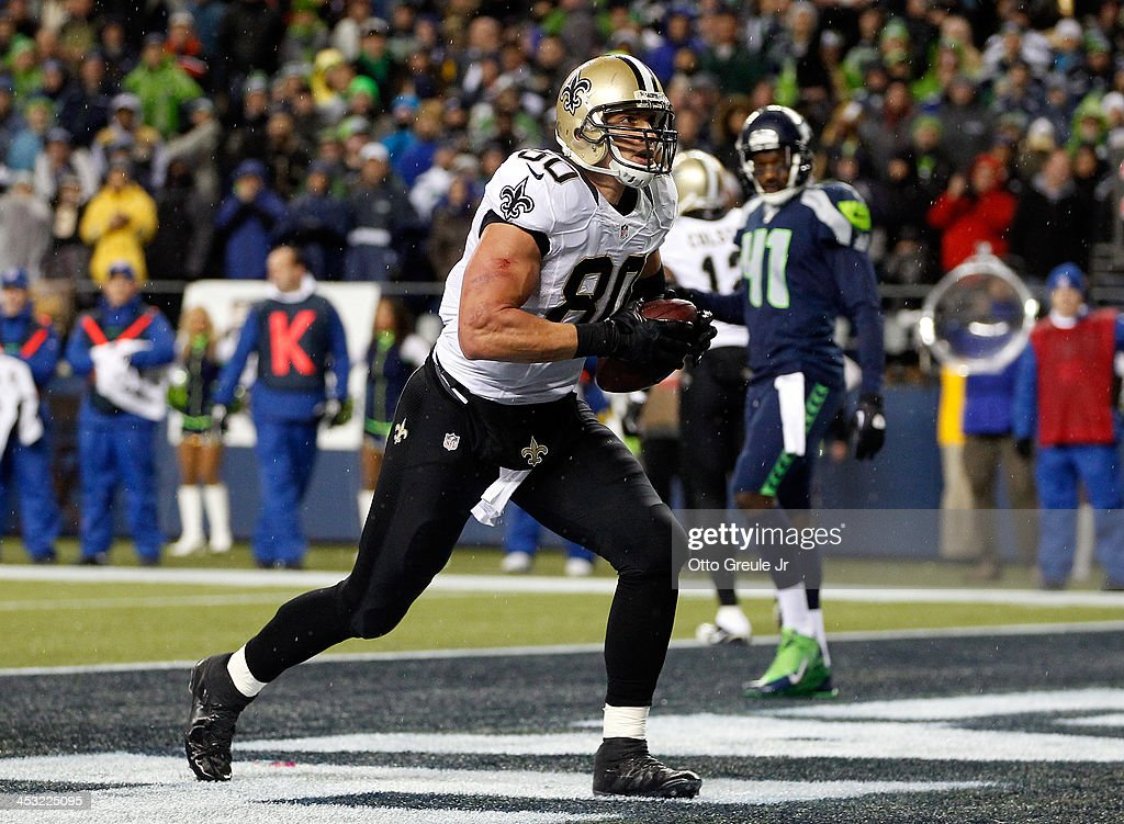 Tight end Jimmy Graham #80 of the New Orleans Saints scores a touchdown in the second quarter against the Seattle Seahawks during a game at CenturyLink Field on December 2, 2013 in Seattle, Washington.