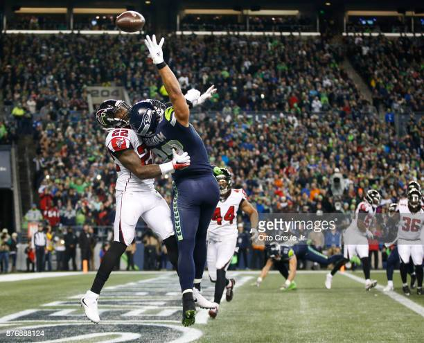 Tight end Jimmy Graham of the Seattle Seahawks can't bring in a pass in the end zone against strong safety Keanu Neal of the Atlanta Falcons during...