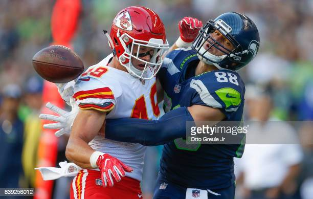 Tight end Jimmy Graham of the Seattle Seahawks can't make the catch as defensive back Daniel Sorensen of the Kansas City Chiefs defends on the play...